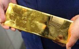 Цена на золото снижается на опасениях повышения процентных ставок США