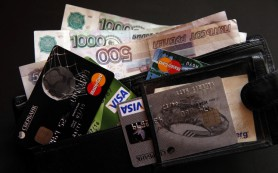 Владельцы Visa и MasterCard, выпущенных банками РФ, могут пользоваться ими в Крыму