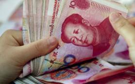 Минфин РФ не спешит переводить нацфонды в юани